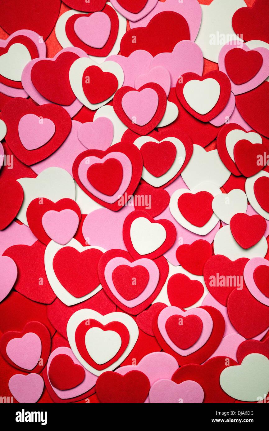 Cuore sfondo per il giorno di San Valentino realizzata con rosa e rosso cuori Foto Stock