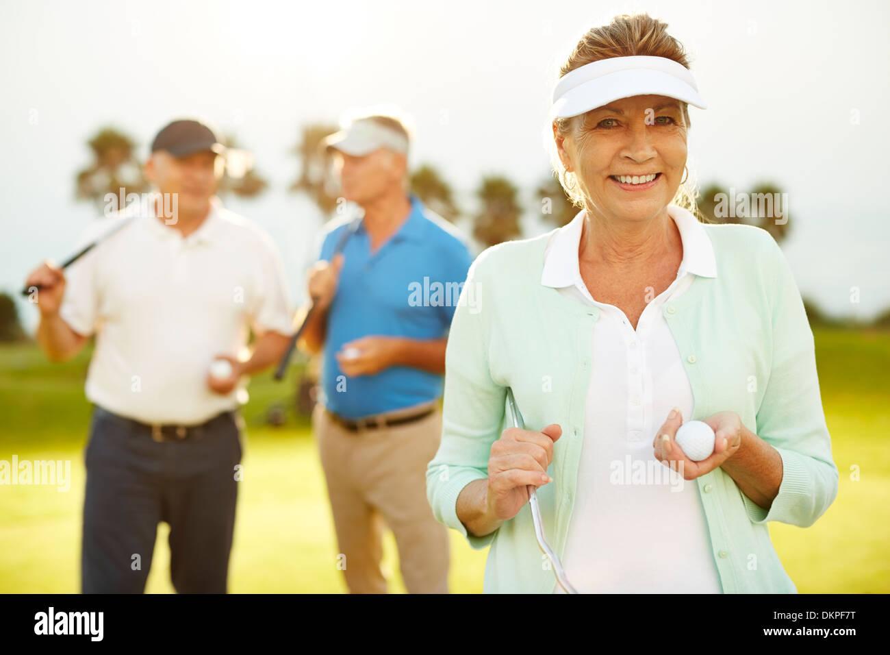 Senior amici sul campo da golf Immagini Stock