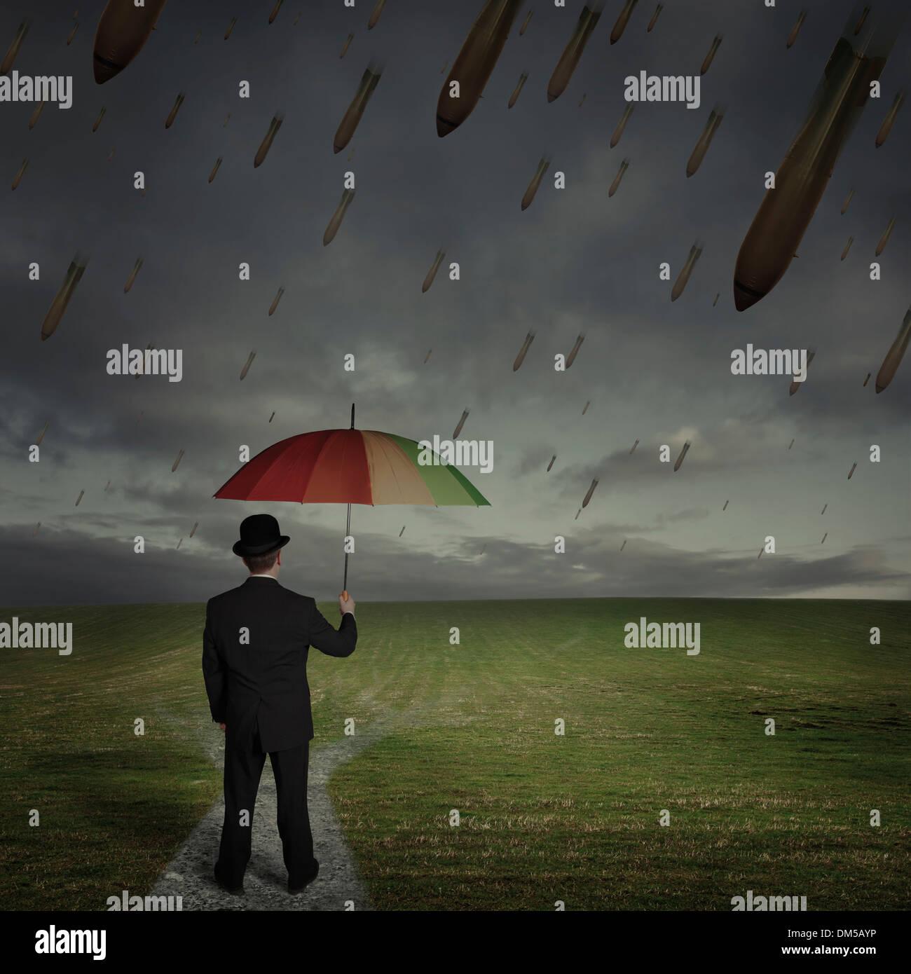 Uomo con ombrello quando la pioggia di bombe Immagini Stock