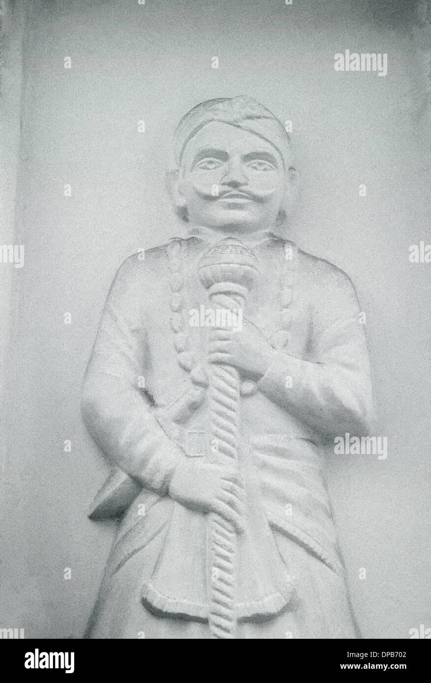 Scultura in Udaipur nel Rajasthan in India in Asia del Sud. Uomo di Rajasthani guerriero Carving scultura Rajput Travel Wanderlust Immagini Stock