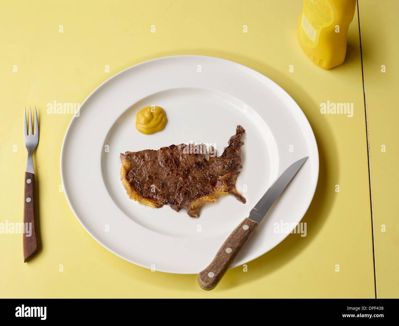 Fetta di carne in forma di noi Immagini Stock
