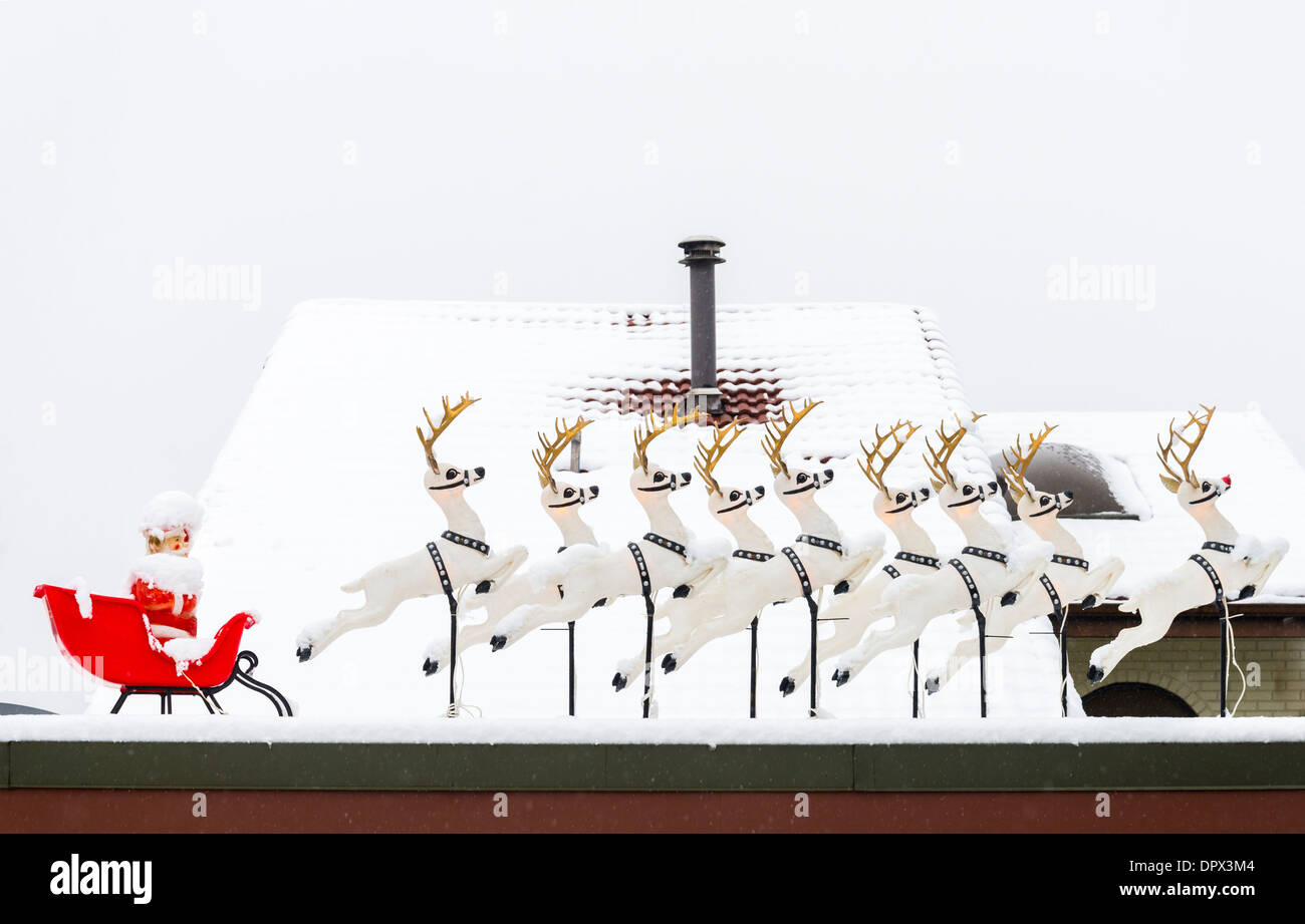 Santa con slitta decorazione del tetto, Immagini Stock