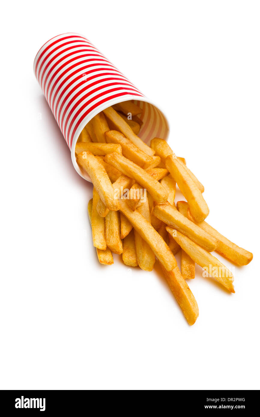 Patate fritte versato all'esterno della tazza Immagini Stock