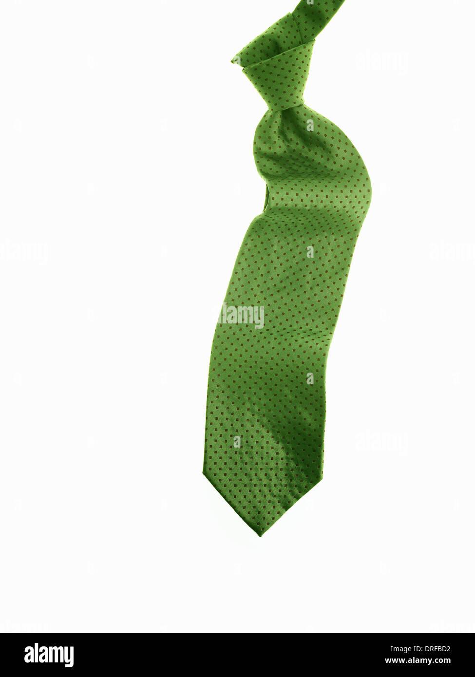 Annodato in tessuto verde e la cravatta cravatta Immagini Stock
