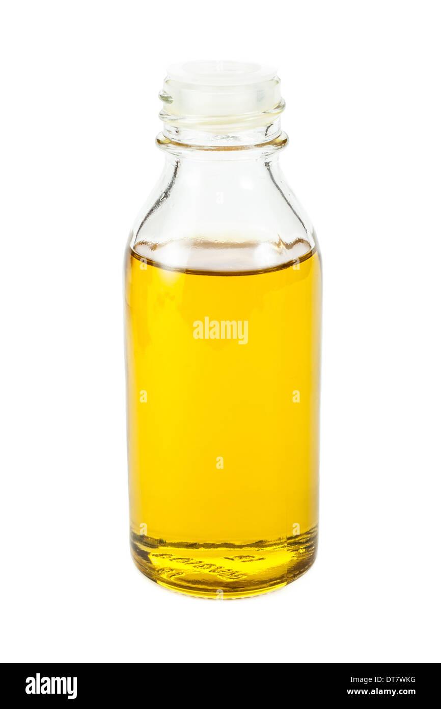Olio di semi di lino in piccola bottiglia isolato su sfondo bianco Immagini Stock