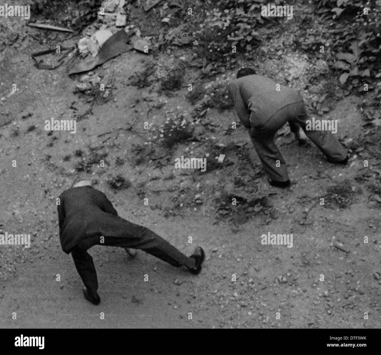 Gli uomini alla ricerca di schegge, 1940 Immagini Stock