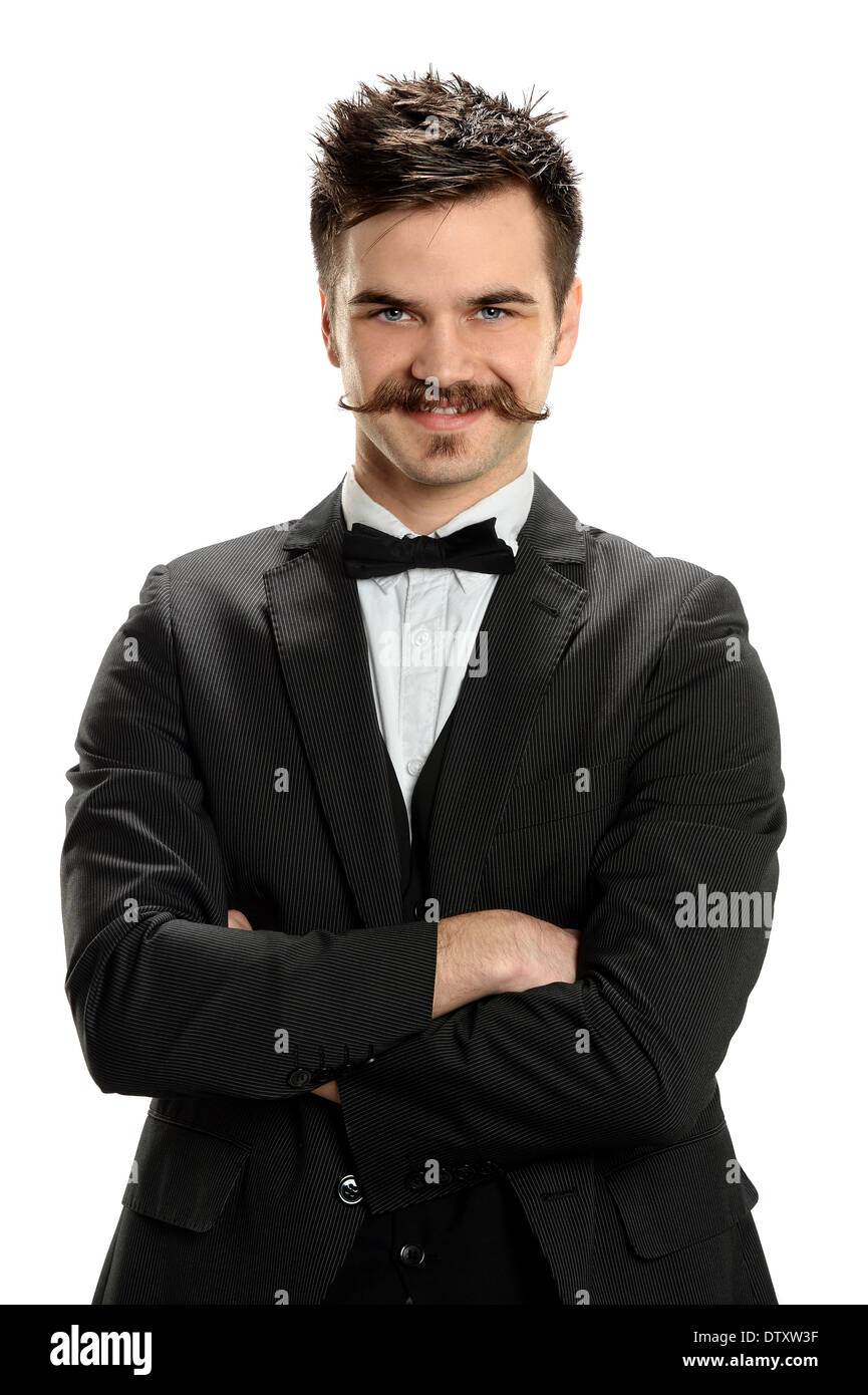 Ritratto di giovane uomo che indossa baffi di fantasia isolate su sfondo  bianco Immagini Stock 879c6f722305