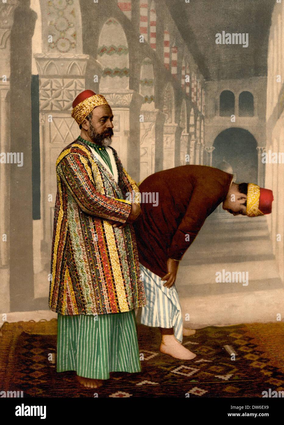 I musulmani pregano, Terra Santa, circa 1900 Immagini Stock