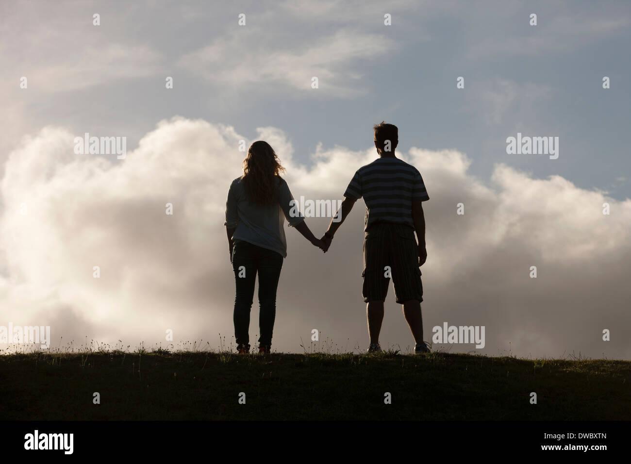 Giovane Holding Hands Immagini Stock
