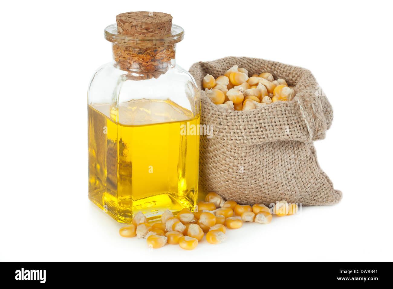 Olio di mais in una bottiglia piccola Immagini Stock
