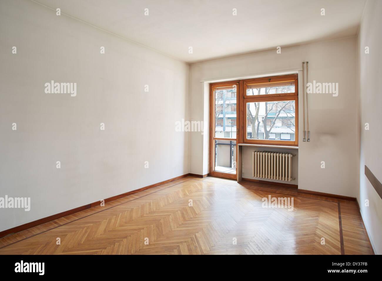 Pavimento Bianco Colore Pareti : Stanza vuota con pavimento in legno e sporco e pareti di colore