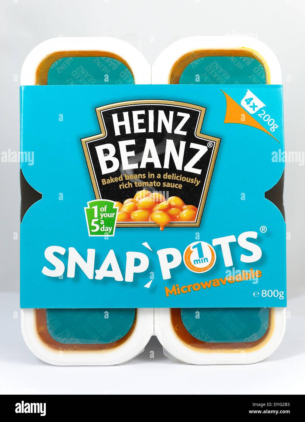 Heinz Beanz snap pentole microondabili fagioli snack Immagini Stock