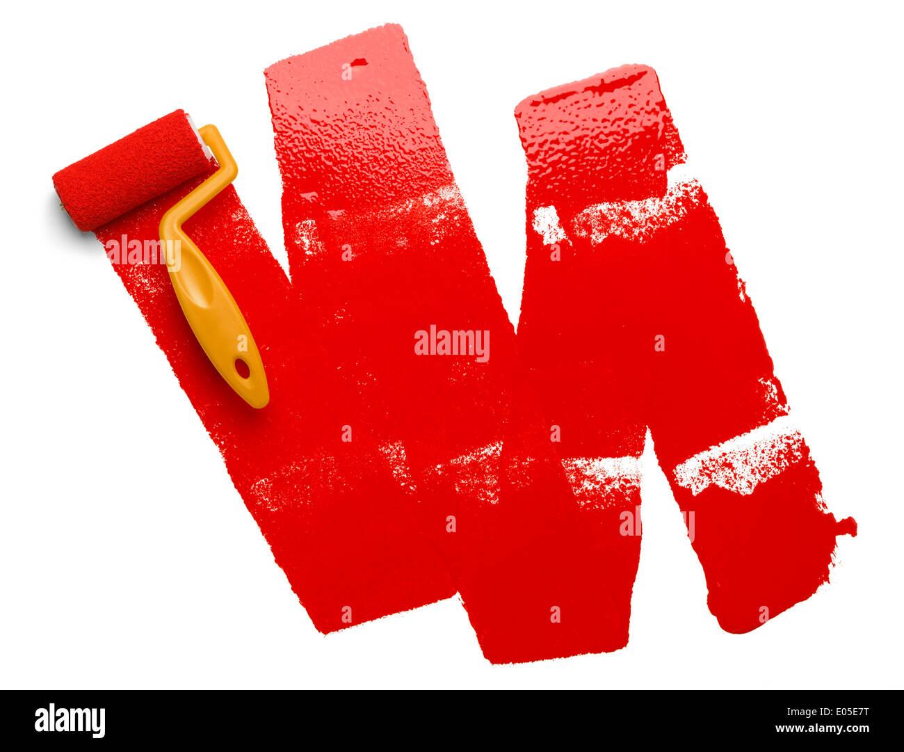 In plastica gialla rullo di verniciatura con vernice rossa isolato sul muro bianco. Immagini Stock