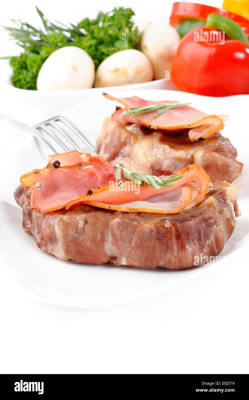 Bistecca di carne di maiale e prosciutto di pepe Immagini Stock