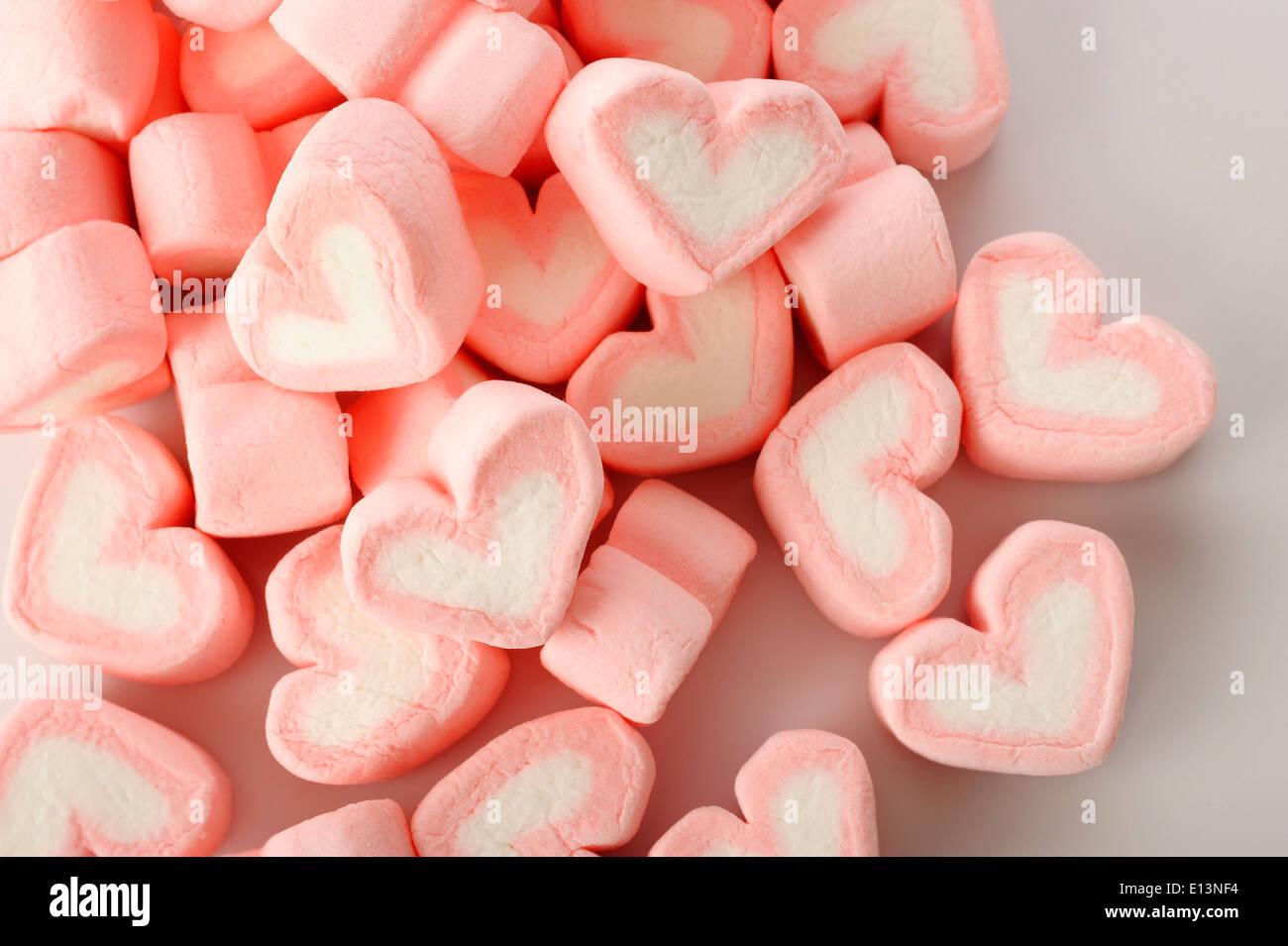 Rosa a forma di cuore marshmallows Immagini Stock