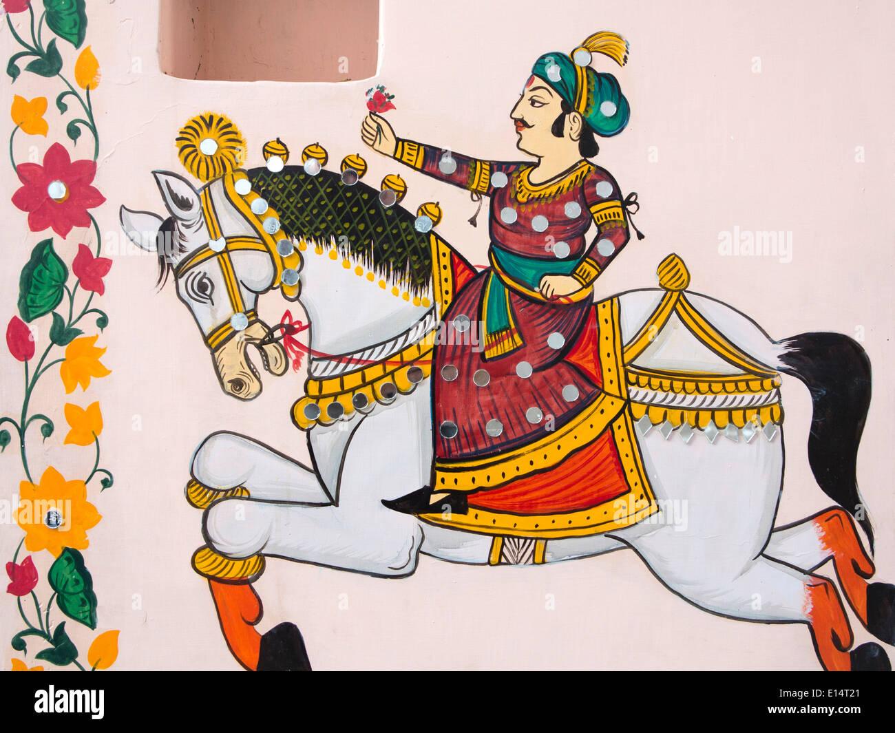 India Rajasthan, Udaipur, Rajasthani arte popolare, pittura murale di Rajput uomo a cavallo con fiore Immagini Stock