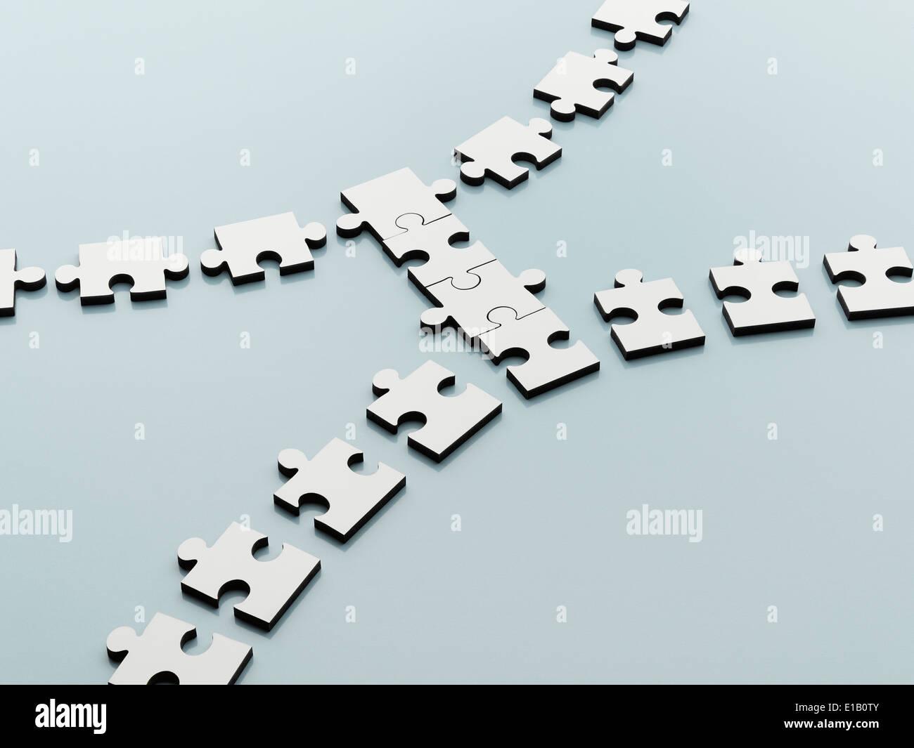 Pezzi di puzzle nel colmare il divario Foto Stock