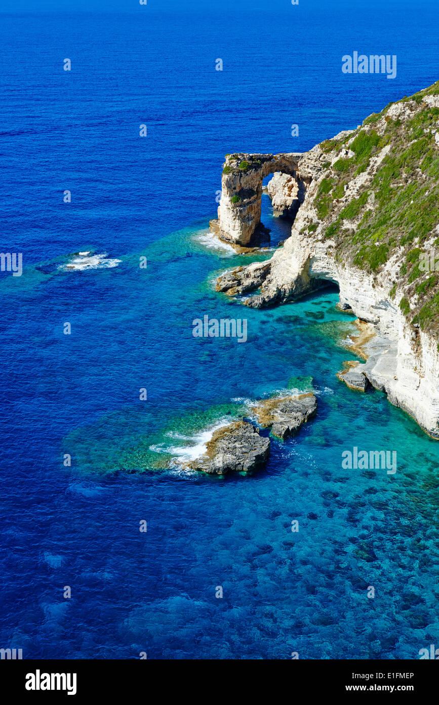 La Grecia, isola del Mar Ionio, Paxi, Tripitos Arch Immagini Stock