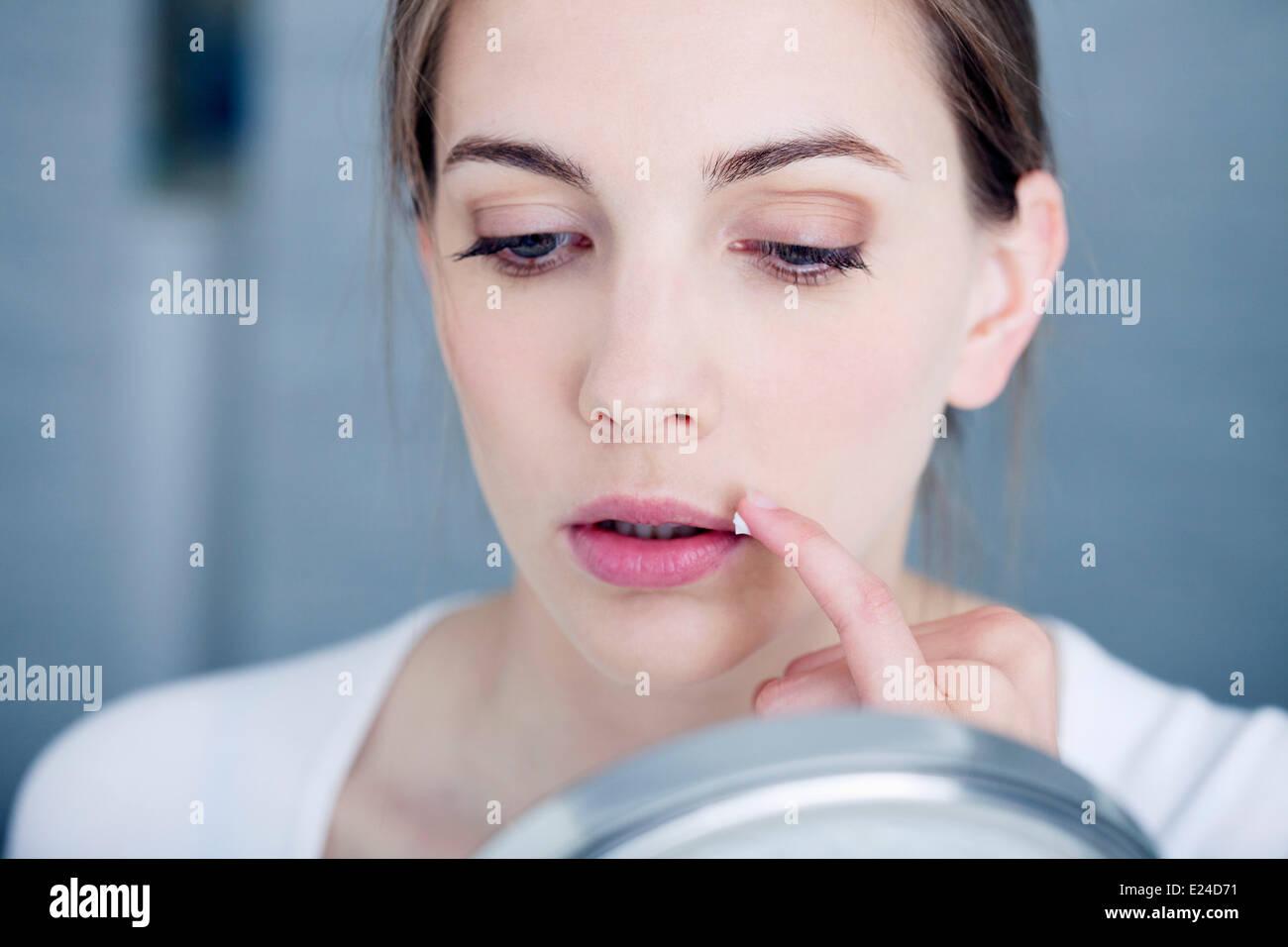 Il trattamento di herpes Immagini Stock