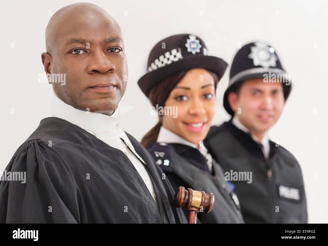 Ritratto di fiducioso giudice e polizia Immagini Stock