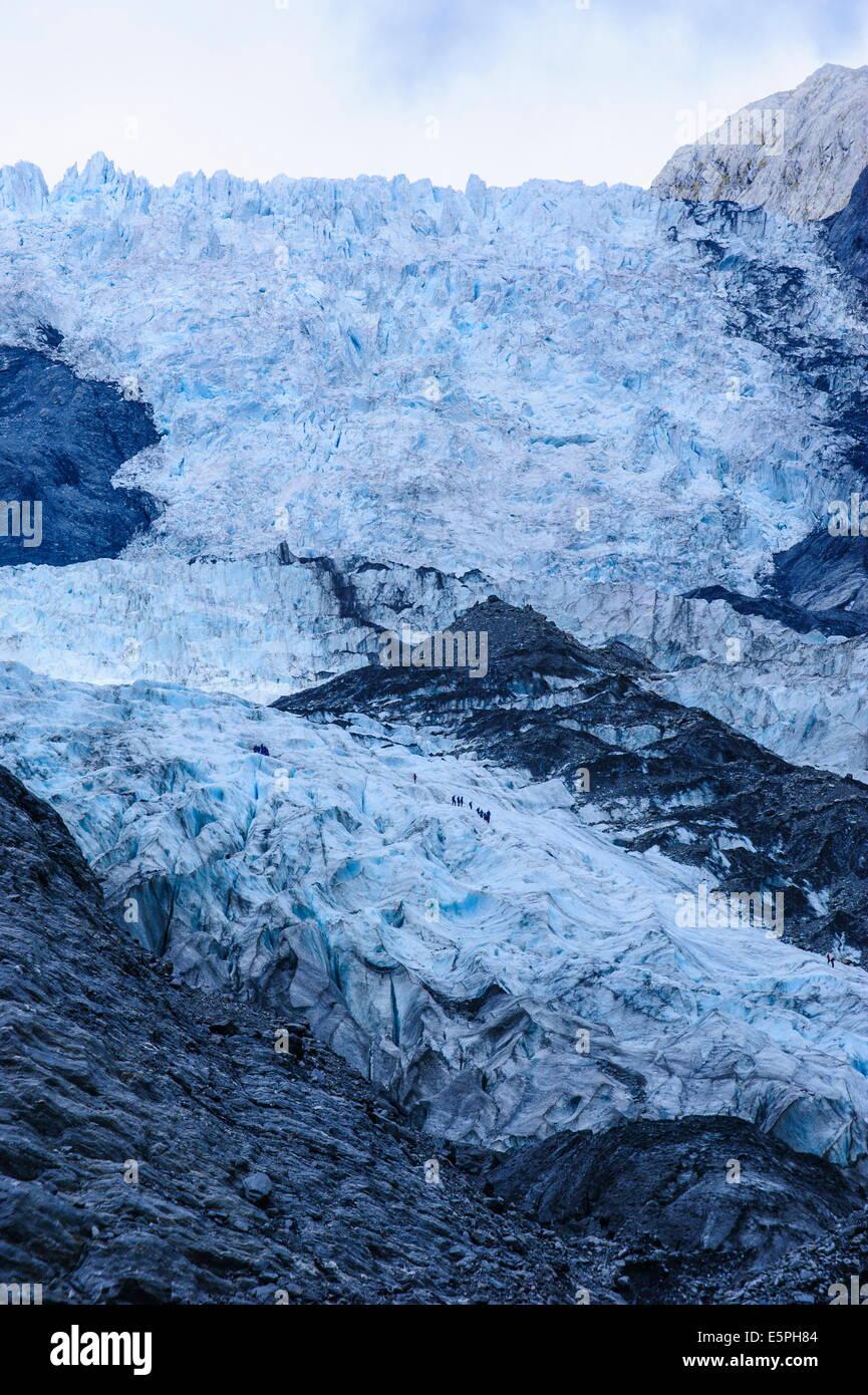 I turisti escursioni sul ghiacciaio Franz-Joseph, Westland Tai Poutini National Park, sito UNESCO, Isola del Sud, Immagini Stock