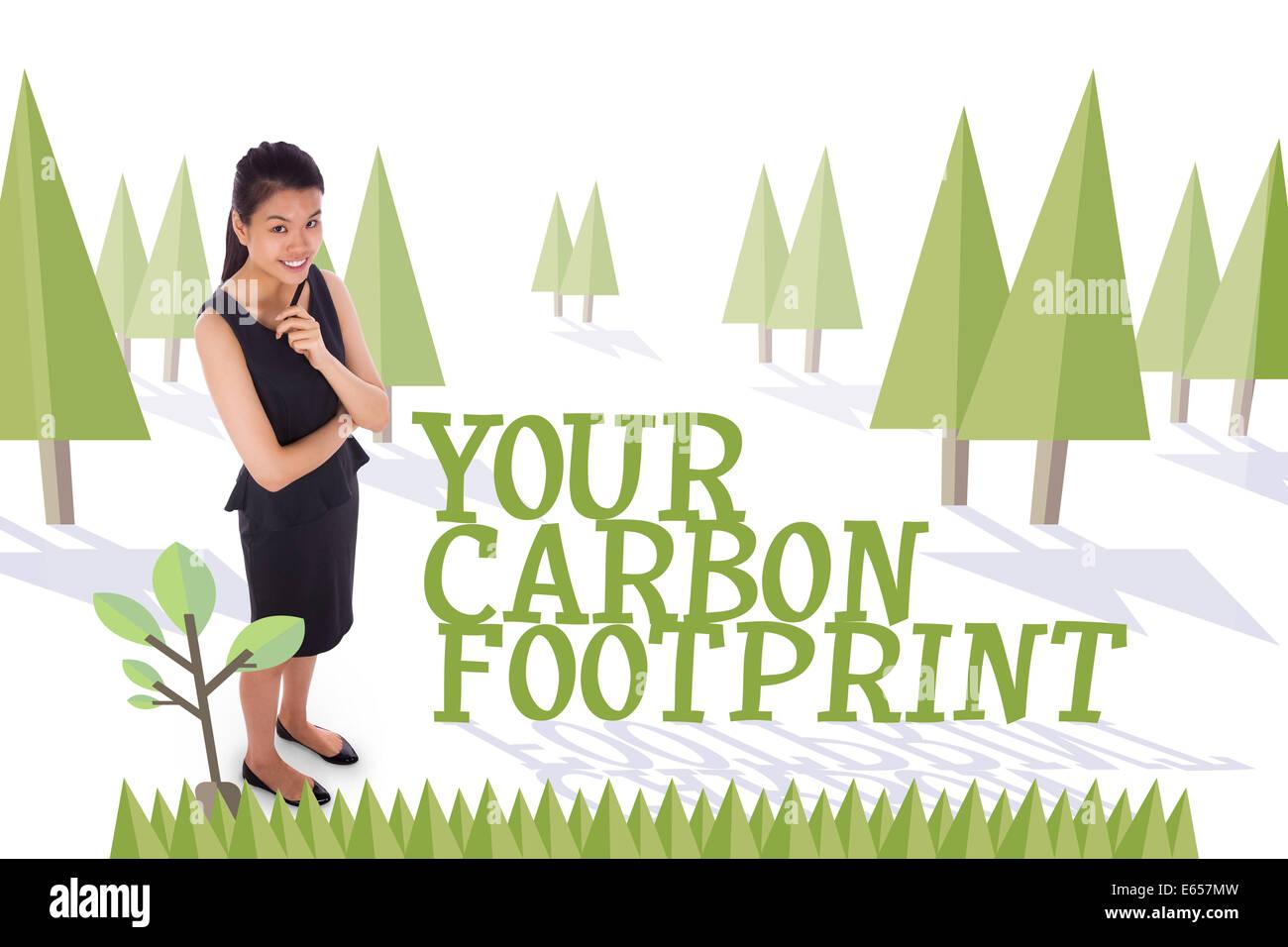 La vostra impronta di carbonio contro la foresta con alberi Immagini Stock