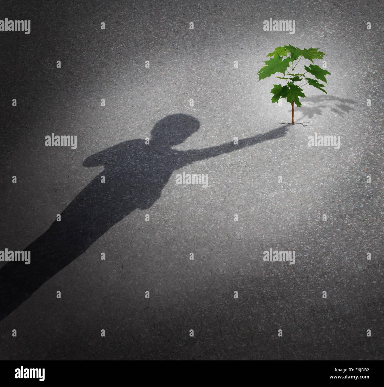 La vita e la speranza come un concetto di crescita con un'ombra di un bambino di toccare un albero alberello Immagini Stock