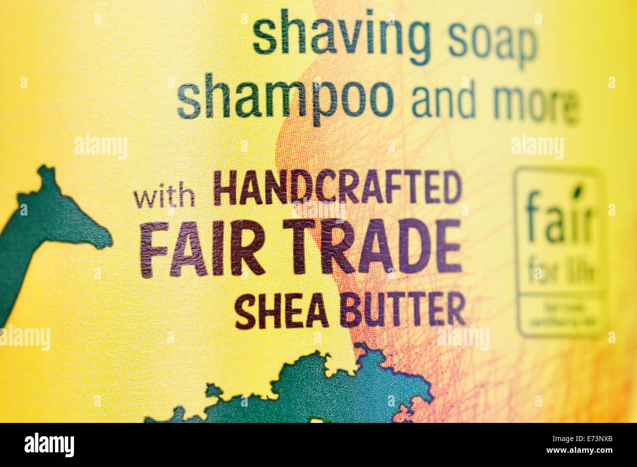 Insegna del commercio equo e solidale sul burro di karitè sapone liquido Immagini Stock