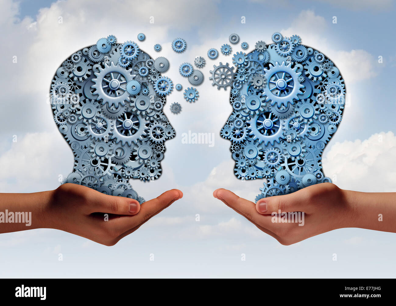 La tecnologia aziendale concetto come due mani di un gruppo di ingranaggi della macchina a forma di una testa umana Immagini Stock