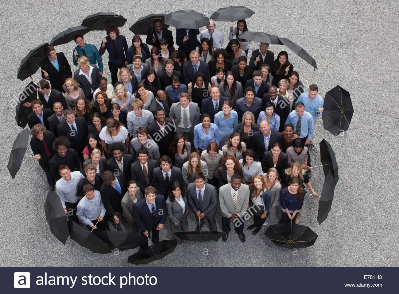 La gente di affari con ombrelloni Immagini Stock