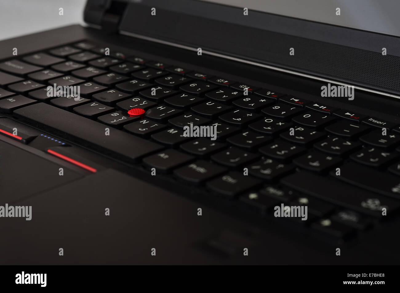 Nero tastiera portatile con red track ball Immagini Stock