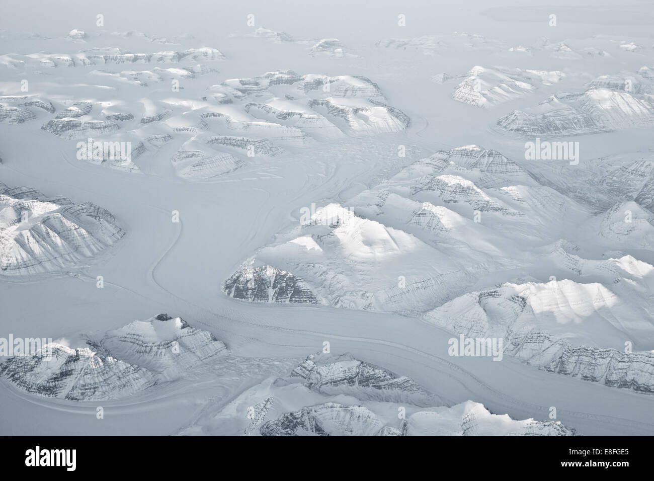 Montagne innevate, Groenlandia Immagini Stock