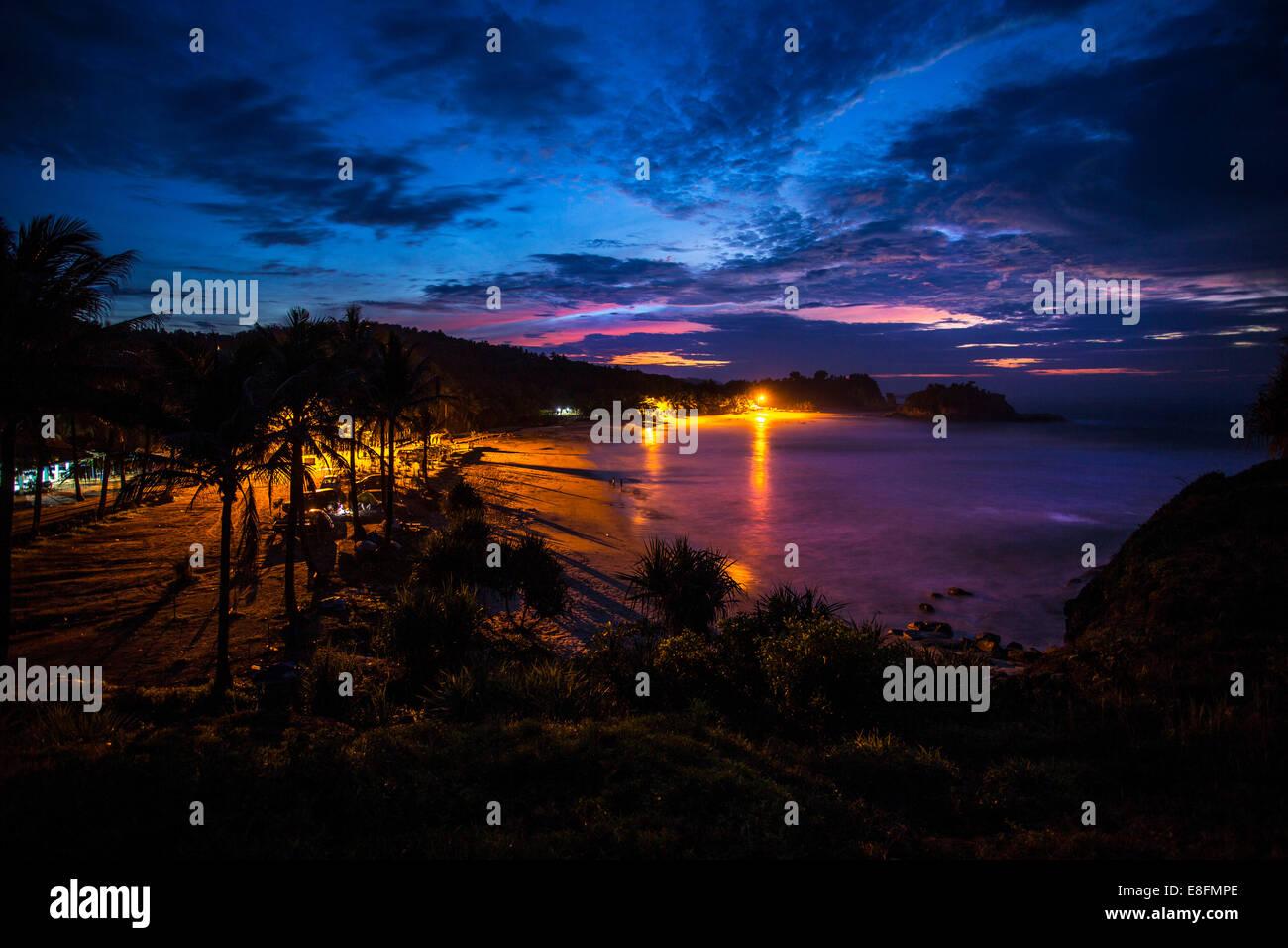 East Java, Klayar spiaggia al tramonto Immagini Stock