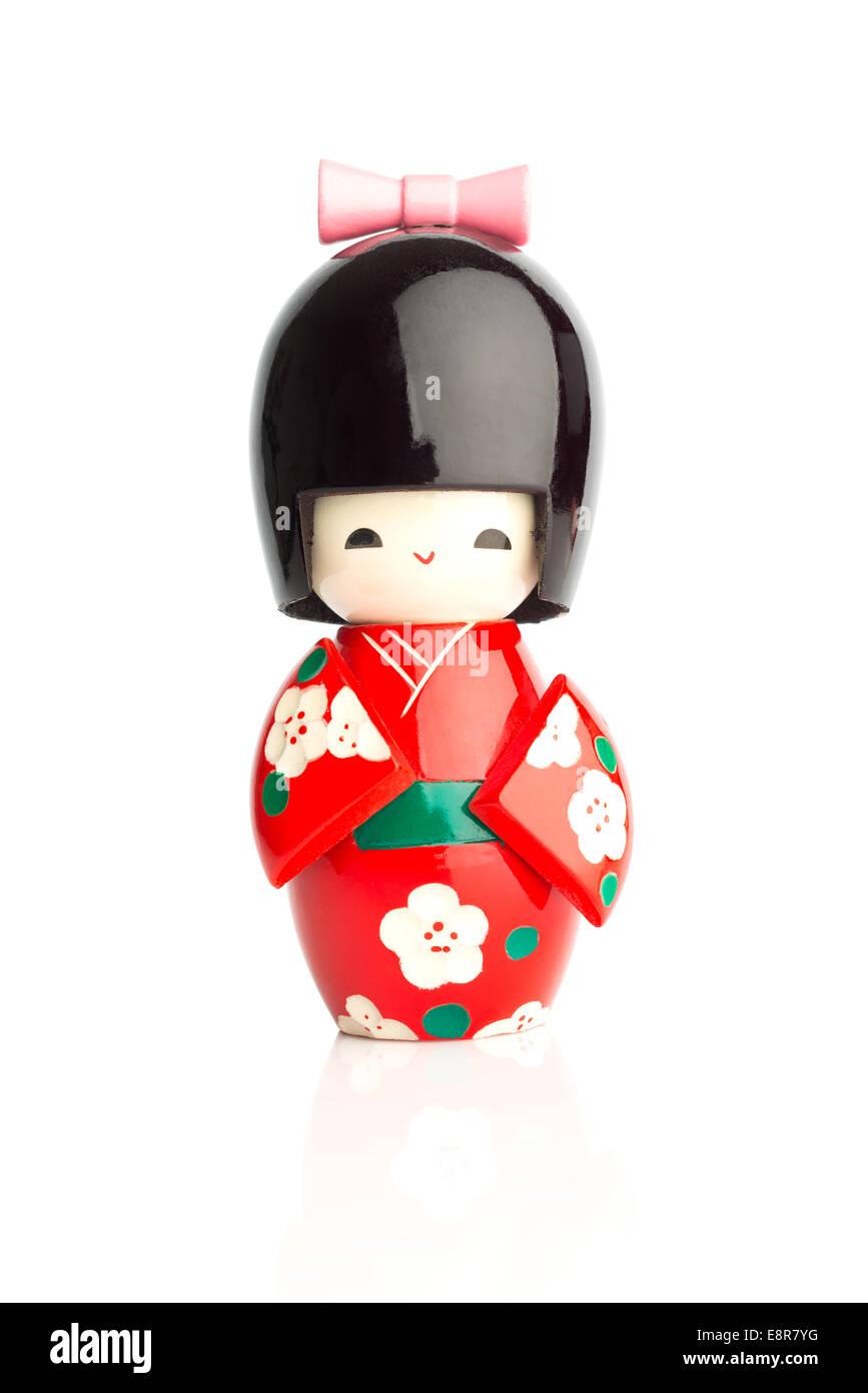 Bambola Kokeshi isolata contro uno sfondo bianco Immagini Stock