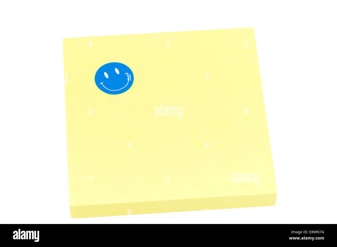Blank bigliettino giallo con smiley Immagini Stock