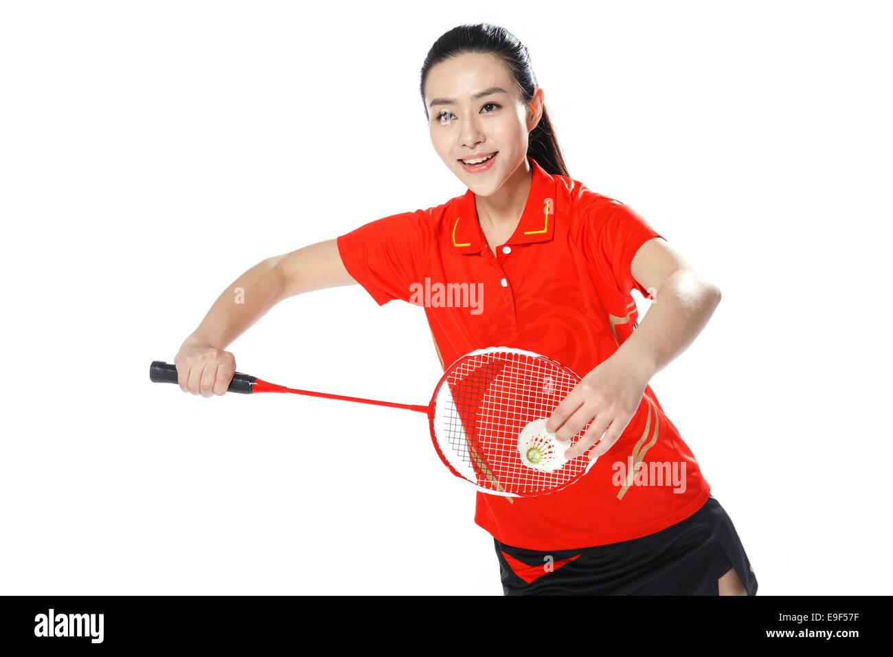 Gli atleti la riproduzione di badminton Immagini Stock