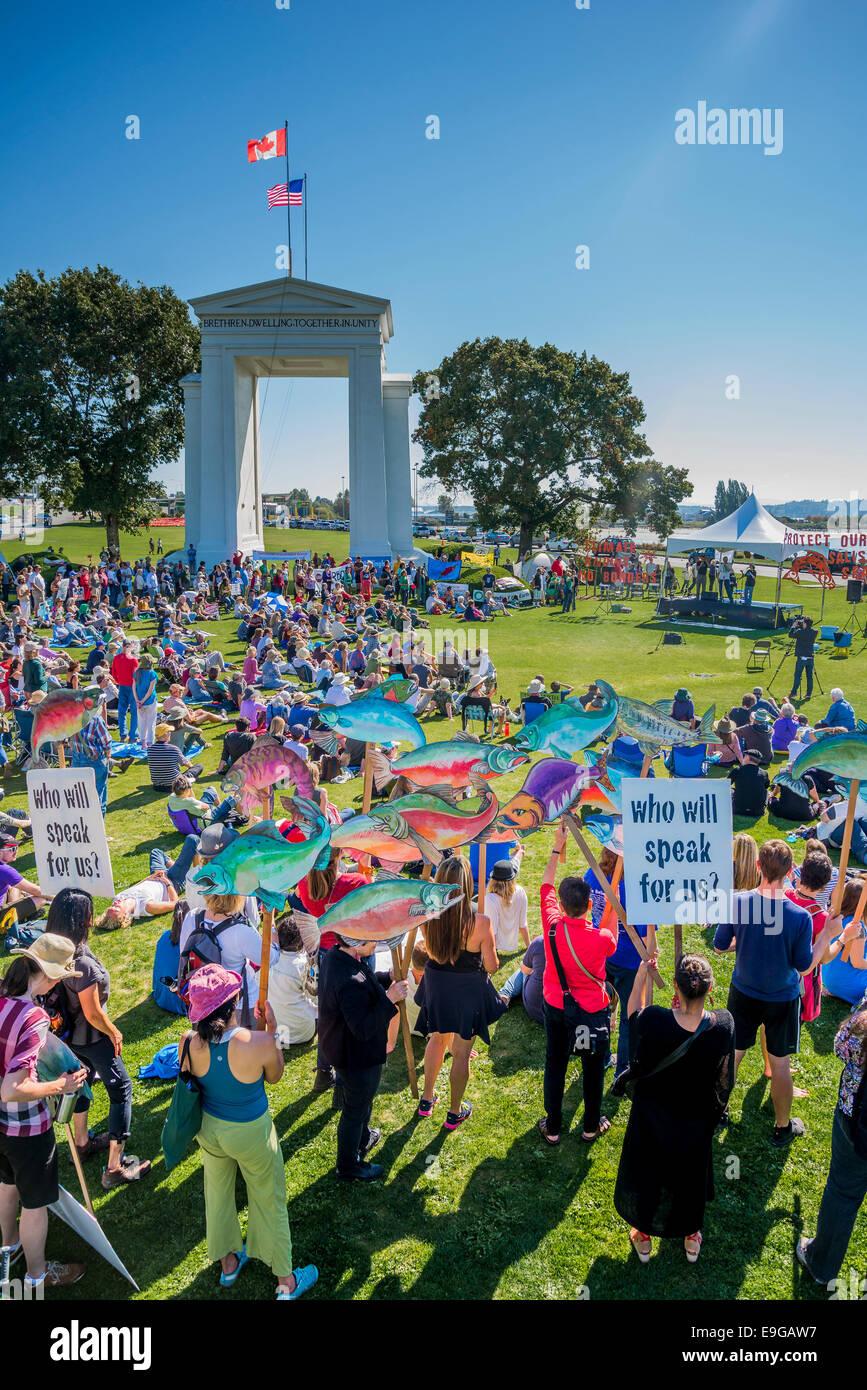 Il cambiamento climatico non conosce confini. Rally internazionale ad Arco della Pace U.S Canada varcare il confine. Immagini Stock