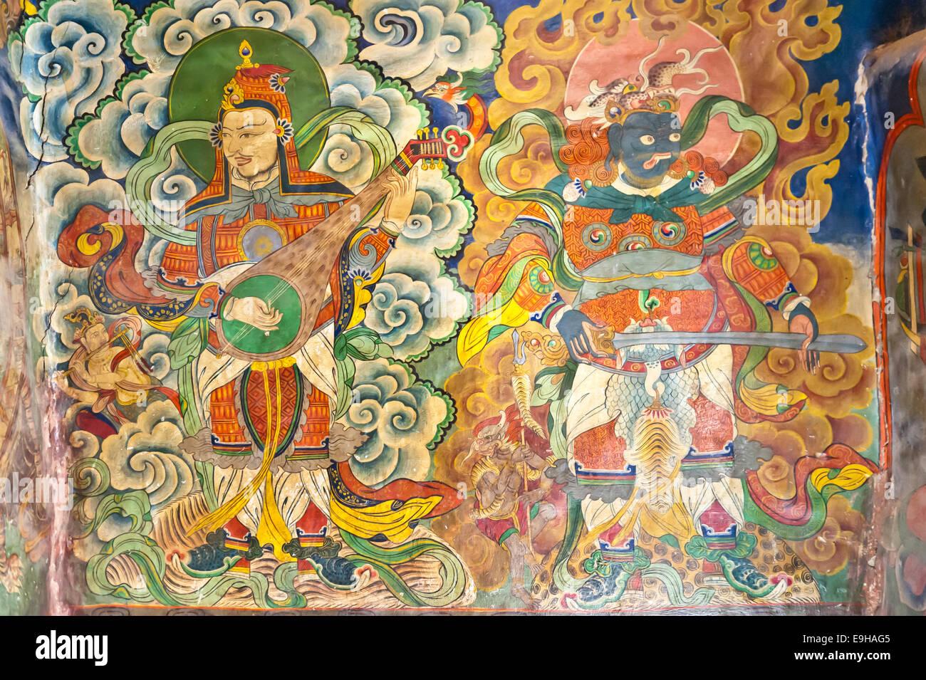 Musicisti e demon murale all'ingresso del Tashi Choling Gompa, Buddismo tibetano, Gieling, Mustang superiore, Immagini Stock