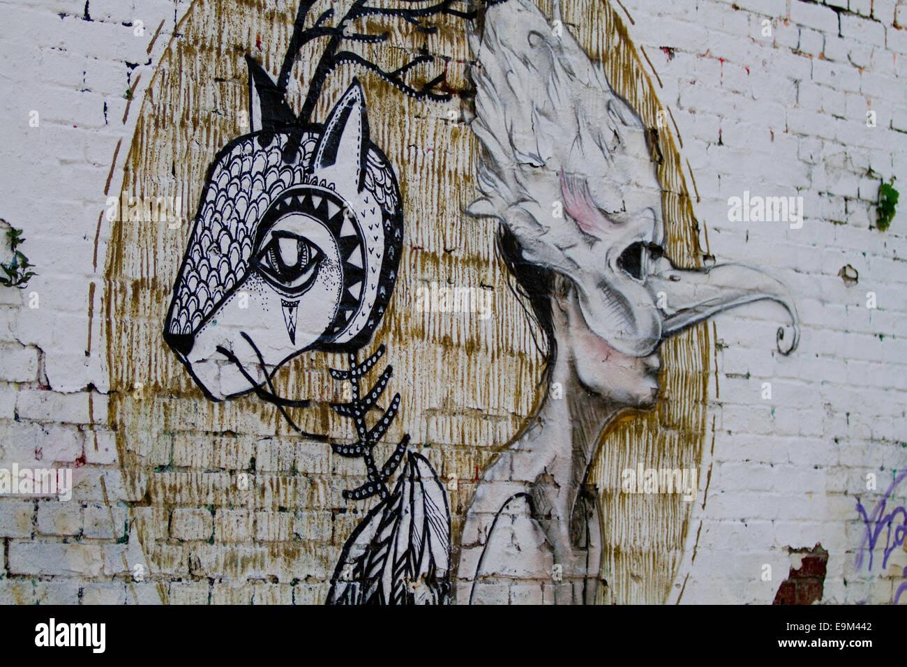 Graffiti arte di strada del muro di Berlino in mattoni color mask Immagini Stock
