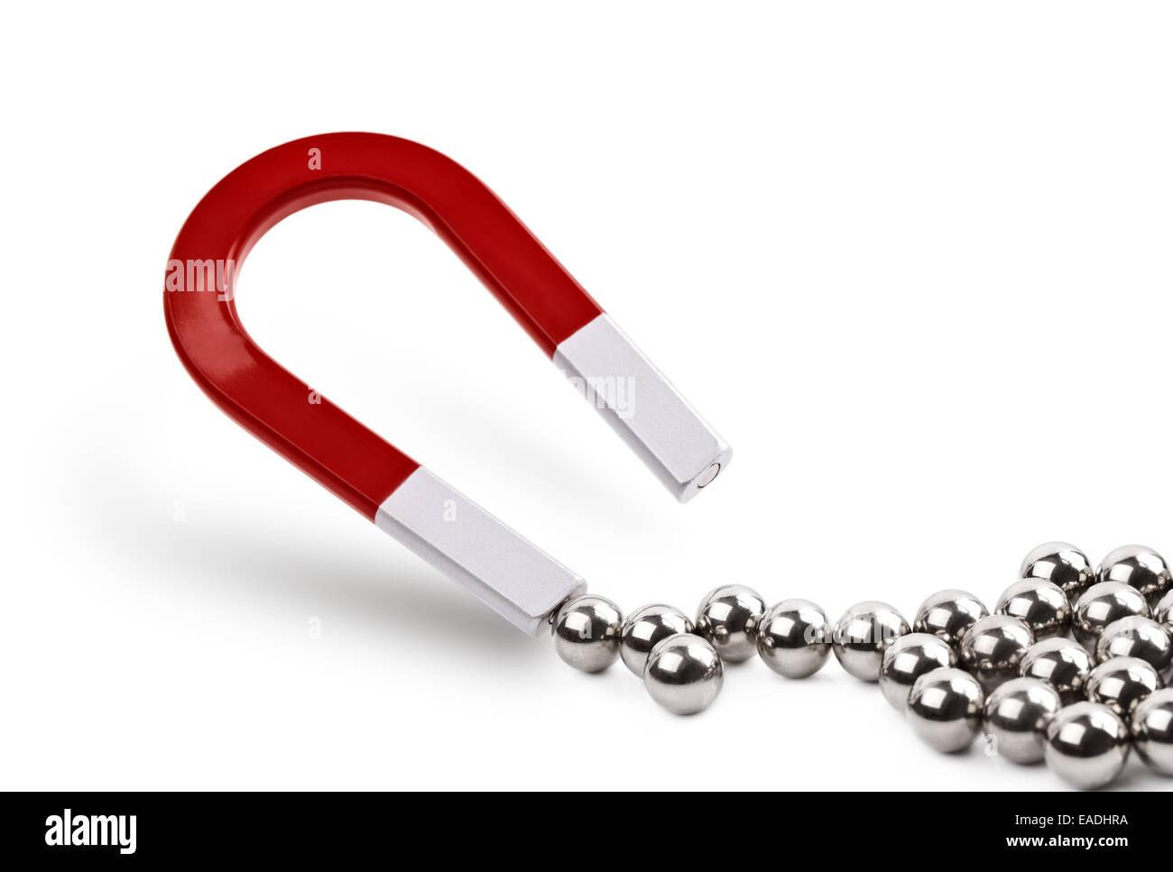 Il magnete di attrazione palline cromate Immagini Stock