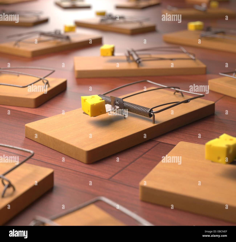 Diversi mousetrap con il formaggio su un pavimento di legno. La profondità di campo in formaggio. Immagini Stock