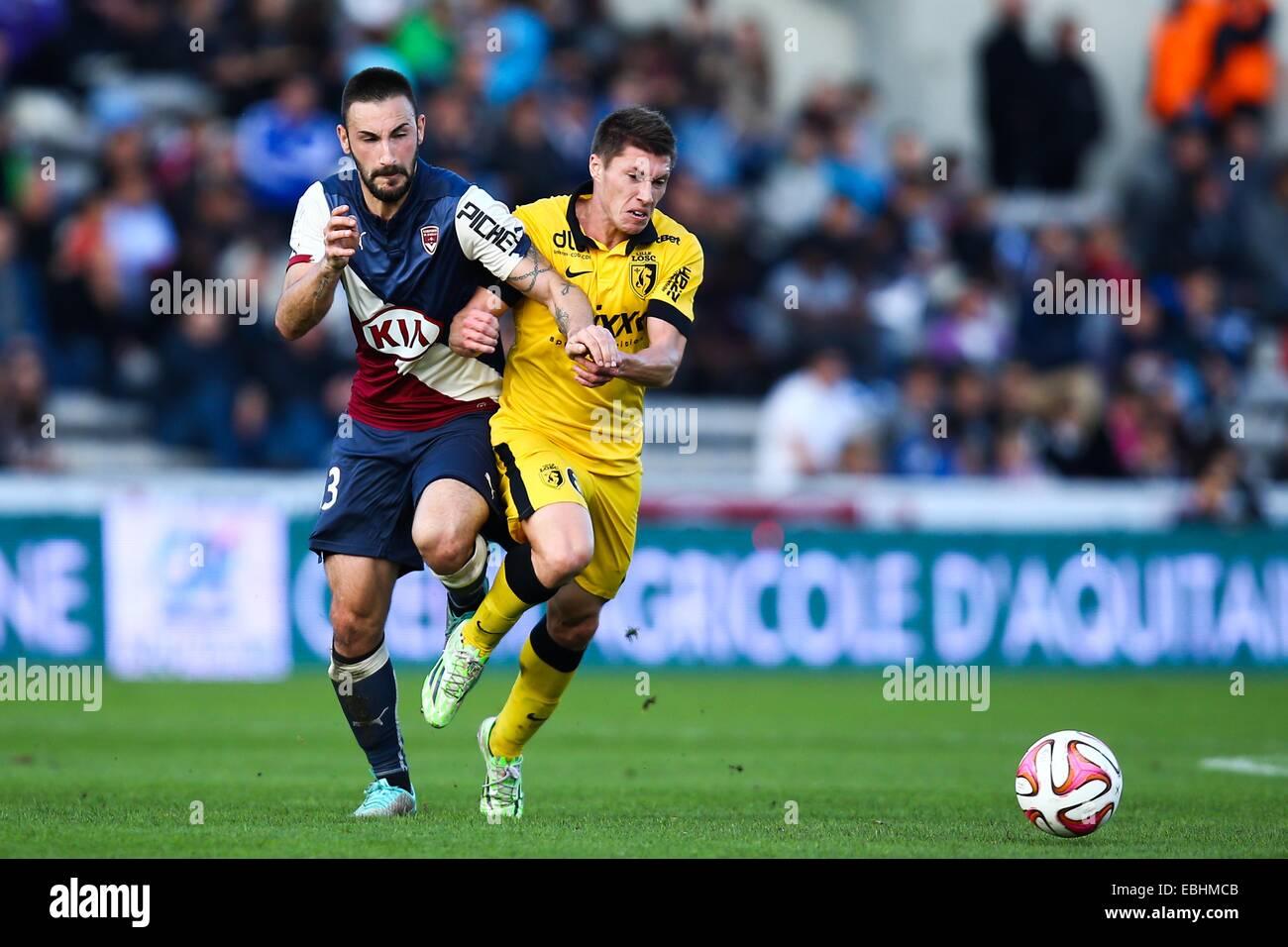 Diego Contento/Jonathan Deplace - 30.11.2014 - Bordeaux/Lille - 15eme journee de Ligue 1 Photo : Manuel Blondau/Icona Foto Stock
