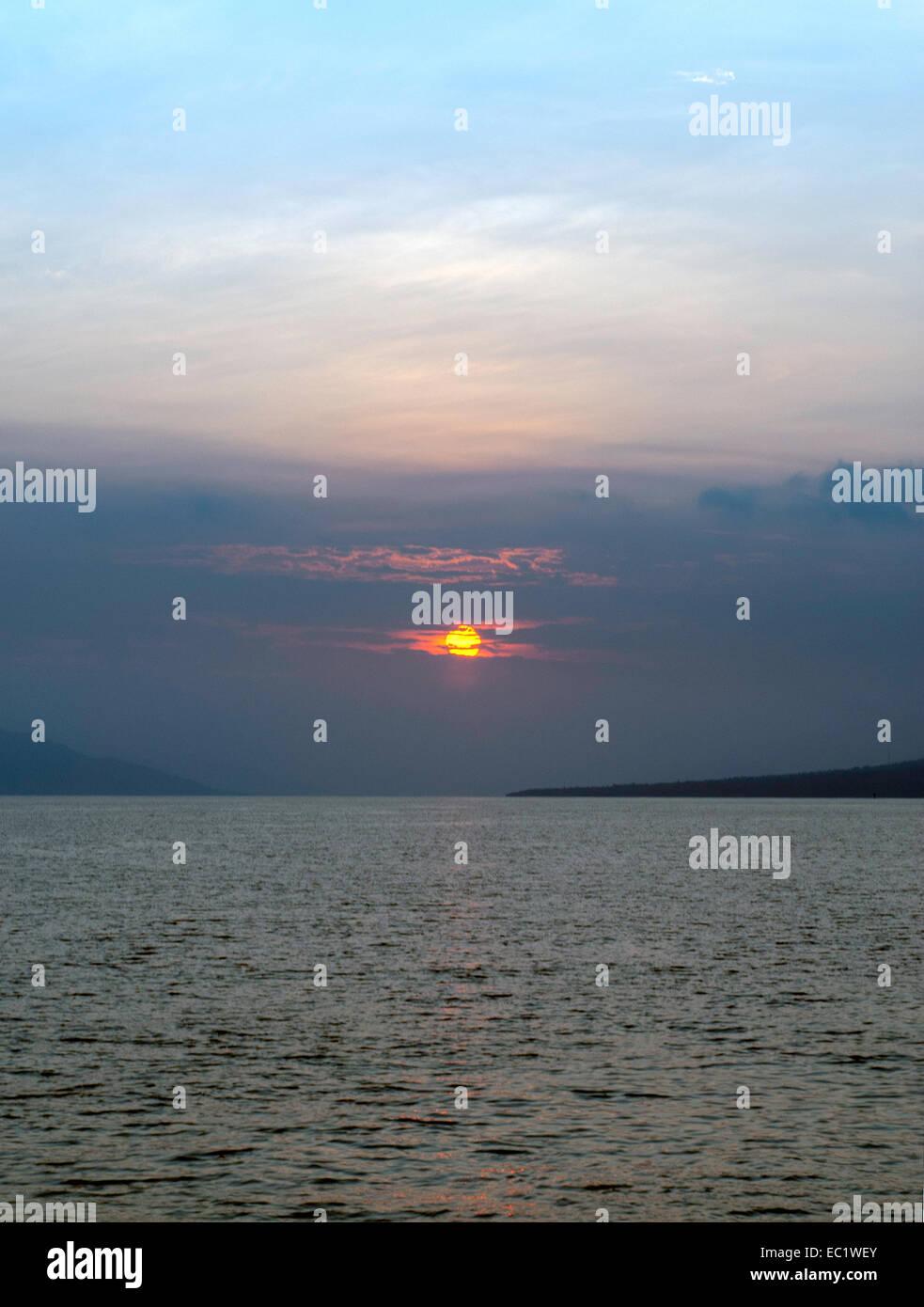 Il tramonto sul mare di Banda Immagini Stock