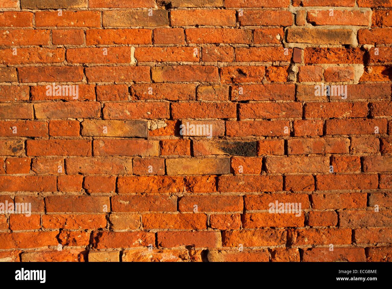 Un vecchio muro di mattoni in background. Immagini Stock