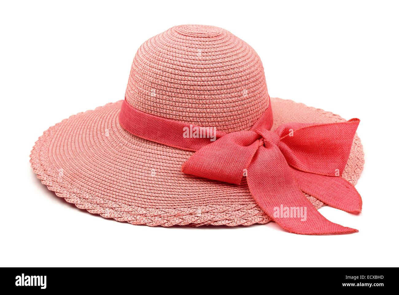 Rosa cappello di paglia con fiocco isolato su bianco Immagini Stock