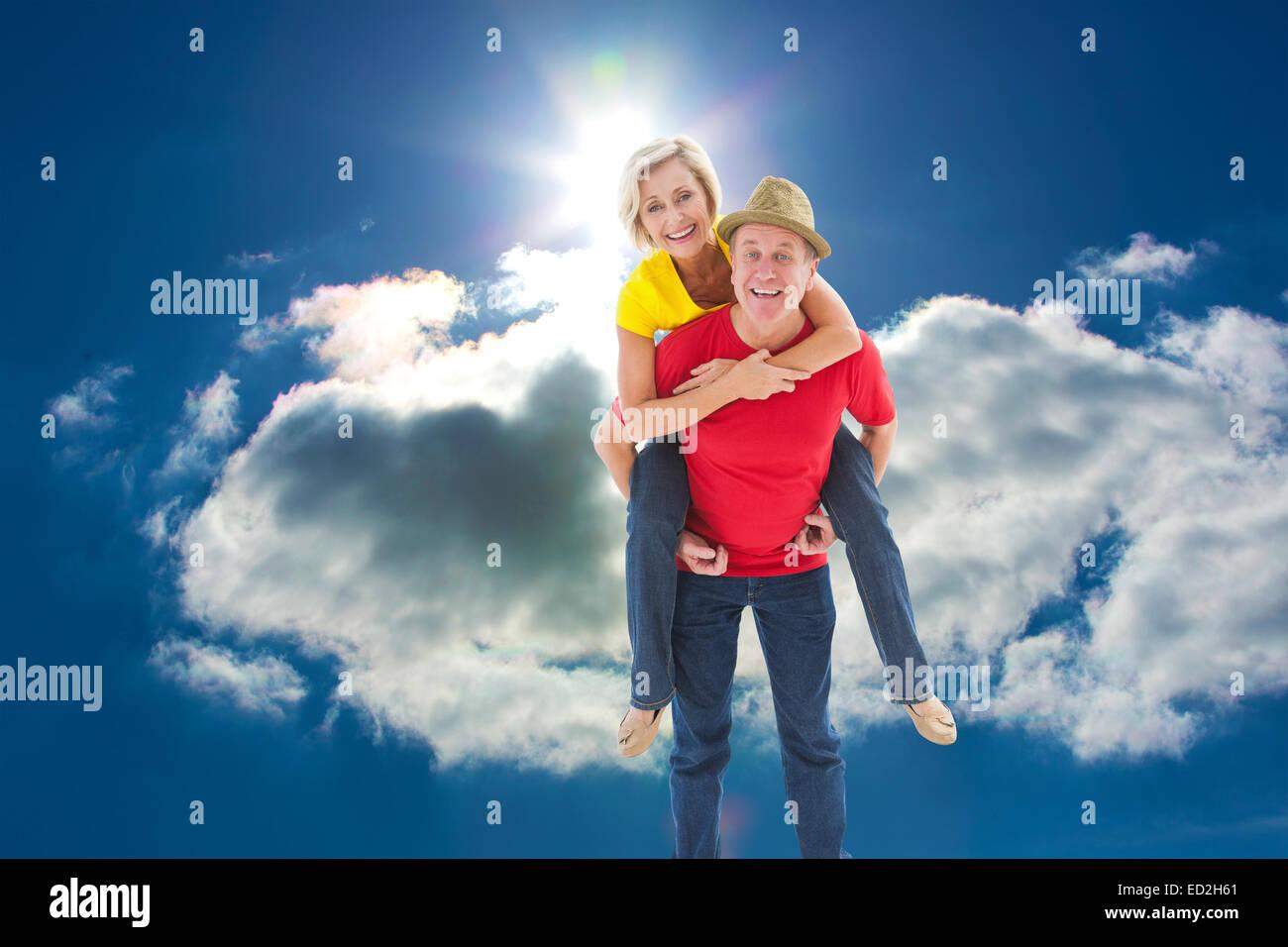 Immagine composita della coppia matura scherzando sulle insieme Foto Stock