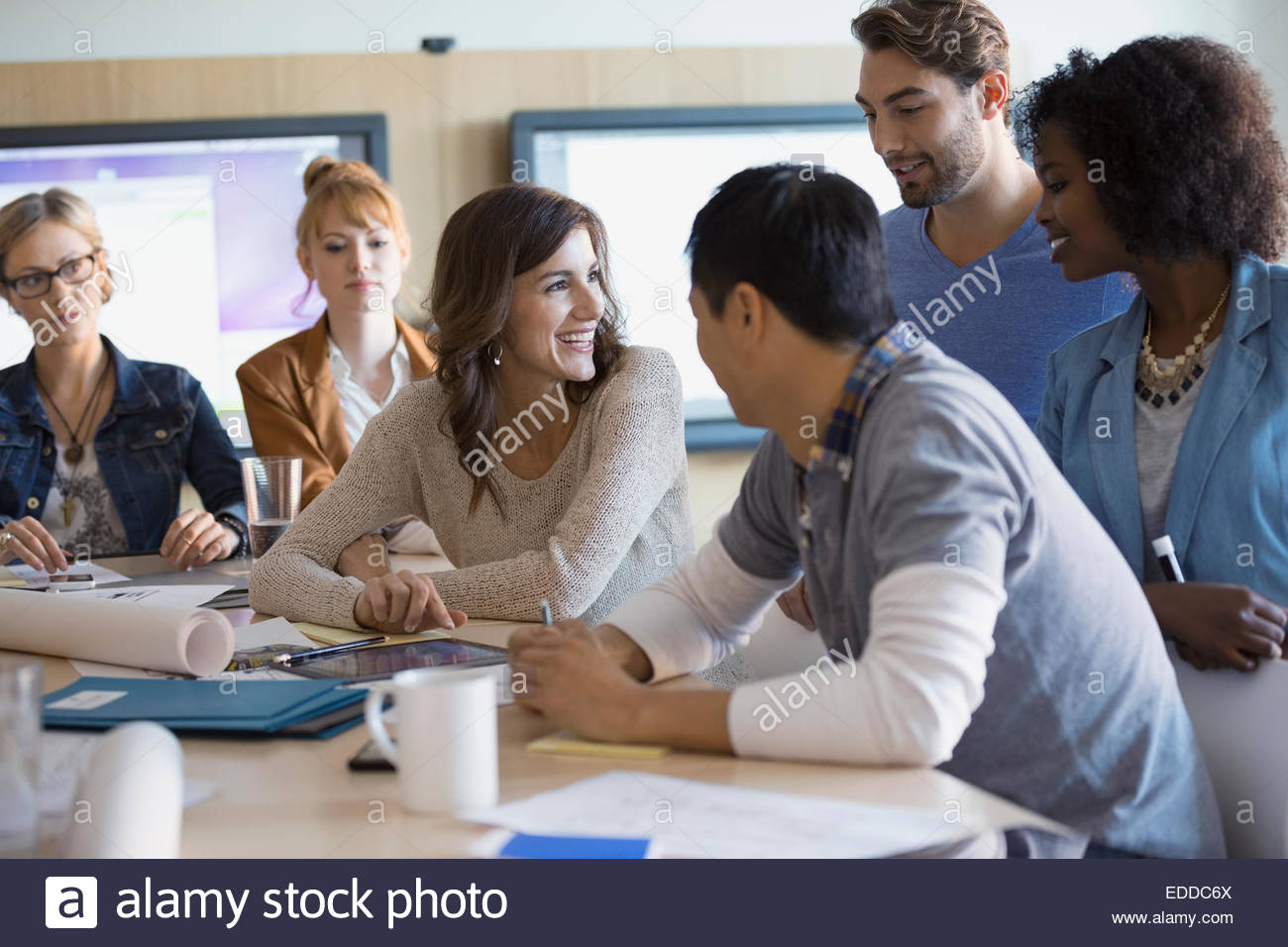Sorridente business persone in riunione Immagini Stock