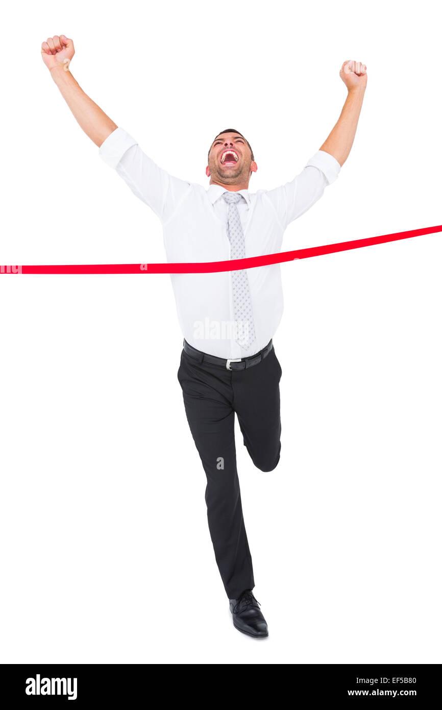 Imprenditore attraversando il traguardo Immagini Stock