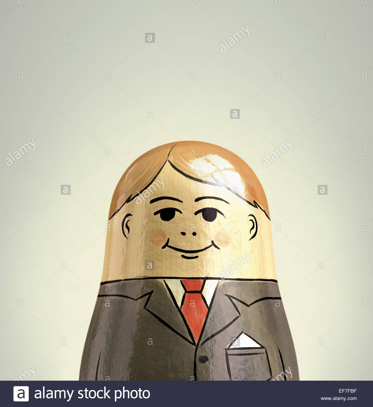 Felice, sorridente imprenditore bambola di nesting Immagini Stock