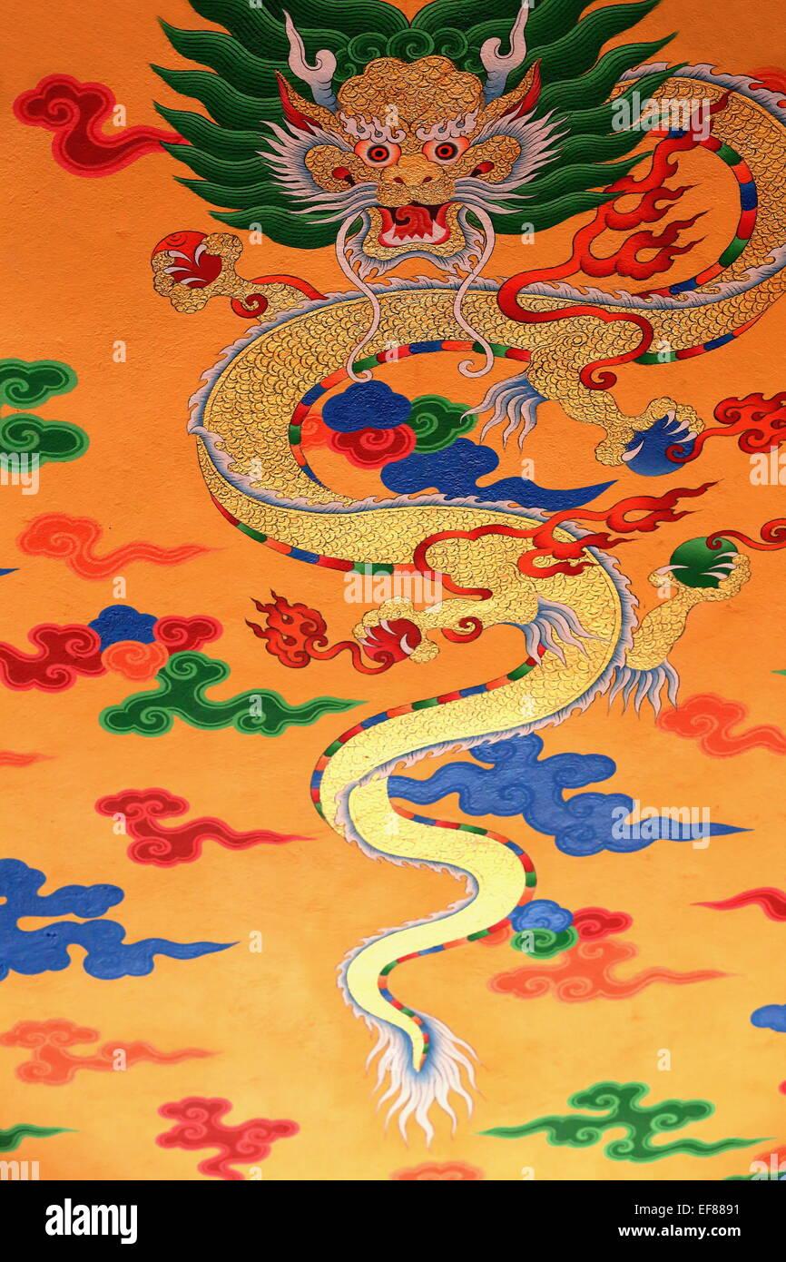 Disegno buddista-Decorazione di colore marrone rossiccio parete dipinta che mostra tradizionale simbolo religioso Immagini Stock